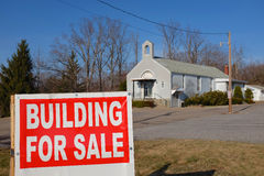 Church for Sale. A church building for sale, part of a consolidation trend for the Catholic Church in the USA.  Also. reflects declining church membership and Royalty Free Stock Photo