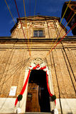 Church  in  the samarate   old   closed brick    lombardy. Church  in  the     samarate  closed brick tower sidewalk italy  lombardy     old Royalty Free Stock Photo