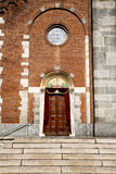 Church  in  the samarate   old   closed brick tower. Church  in  the     samarate  closed brick tower sidewalk italy  lombardy     old Royalty Free Stock Image
