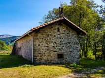 Church of San Donato in the valley of Araiz with the mountains of Aralar from the area of Betelu, Navarra. Spain stock photos