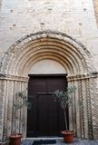 Church of San Francesco in Staffolo medieval village, Italy. Romanesque style portal of the Church of San Francesco. Medieval village of Staffolo, Province of royalty free stock images