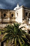 Church of San Fransisco el Grande with huge palm tree in backyard , Antigua, Guatemala. Church of San Fransisco el Grande with huge palm tree in backyard and stock image