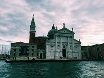Church of San Giorgio Maggiore by Grand Canal against cloudy autumn sky Stock Photos