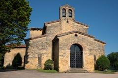 Church of San Julian de los Prados, Oviedo, Spain. Old Church of San Julian de los Prados with trees and blue sky, Oviedo, Spain stock image