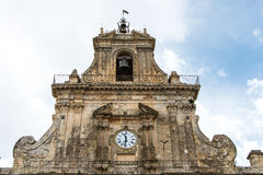 Church of San Sebastiano in Palazzolo Acreide, Siracusa, Sicily,. Detail of the facade of the church of San Sebastiano against a cloudy sky in Palazzolo Acreide Royalty Free Stock Photography