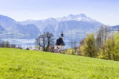 Church Sankt Andreas with beautiful view to the Attersee in Aust Royalty Free Stock Image
