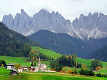 The church Santa Maddalena with the impressive Odle Mountains Group in the background at sunset. stock photo