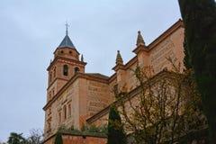 Church of Santa Maria de Alhambra, Granada, Spain, low angle view. Church of Santa Maria de Alhambra, Granada, Spain, surrounded by trees and shrubs, low angle royalty free stock image