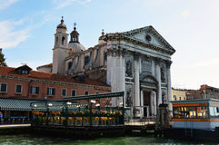 Church of Santa Maria del Rosario o dei Gesuati with restaurant on lagoon and ferry stop Zattere, Venice, Italy Royalty Free Stock Photography