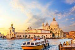 Church of Santa Maria della Salute and the boat near the pier in. Venice, Italy royalty free stock photo