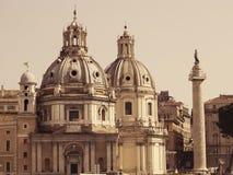 Church of Santa Maria di Loreto and Colonne Trajane. View of the two domes of the Church of Santa Maria di Loreto and Colonne Trajane. Rome, Italy. Retro toned Stock Image