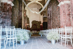 Church, Santa Maria Regla Ranch, Huasca de Ocampo Hidalgo, Mexico. 17th May. Church interior decorated for wedding ceremony with white chairs and flowers stock image