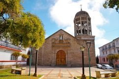 Church Santo Domingo in La Serena, Chile. Low angle view of the stone church Santo Domingo  with a blue sky with some clouds in La Serena, Chile, South America Royalty Free Stock Photography