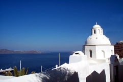 Church in Santorini. One of the 500 churches of the small island of Santorini, in Greece. The white bell tower contrasts with the dark blue of the sky stock photography