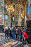 Church of the Savior on Blood.Visitors of the church and a tired woman sleeping on a chair. Royalty Free Stock Image