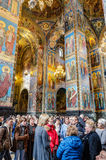 Church of the Savior on Spilled Blood. The visitors listening a guide. Stock Photos