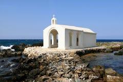 Church and Sea. White church against blue sea in Crete, Greece Stock Photography