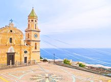 Church by sea decorated with ribbons. Beautiful old church of San Gennaro decorated with colorful ribbons for Easter overlooking sea on sunny day in Praiano Stock Image