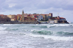 Church with sea 1. Elegant church in an Asturian town with sea, waves and grey sky Royalty Free Stock Photo