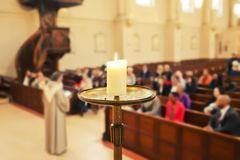 Church service. Candle by Church service background stock photo