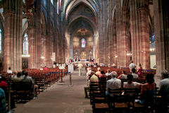 Church service in Notre-Dame cathedral. Church service in Cathedrale Notre-Dame, Strasbourg, France on July 11, 2010 Royalty Free Stock Image