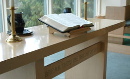 Church Services. Inside view of a church with the bible open on a table Royalty Free Stock Photos
