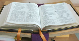 Church Services. Inside view of a church with the bible open on a table Stock Images