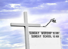 Church Services. Church service schedule with light and a cross Royalty Free Stock Photography