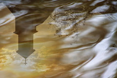 Church shadow in the water Royalty Free Stock Images