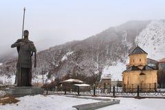 The church, Shioda Gudashauri Spiritual and Cultural Centre, the king David's statue in Sno village in winter Stock Image