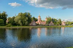 Church on the shore of the pond. MOSCOW, RUSSIA - 23 JULY, 2017: Altufyevo Manor and Church of the Exaltation of the Holy Cross. Altufevsky Pond in a recreation Stock Photo