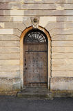 Church side door with skull and bones Royalty Free Stock Image