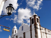 Church, sign and lamppost. In Monsaraz, southern Portugal stock photography