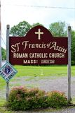Church. Signage at ST Francis of Assisi Assist Church, a small rural Roman Catholic Church in Constable, New York royalty free stock photos