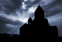 Church silhouette. Old medieval church silhouette against dramatically colored cloudy sky background Stock Images