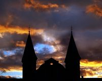 Church silhouette against sky. A silhouette of a church against a nighttime sky Stock Images