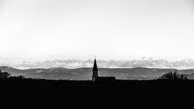 Church silhouette on mountains background Stock Image