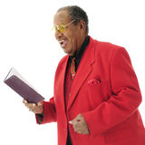 Church Singer. Close-up image of a dressed-up senior African American singing from a hymnal.  On a white background Royalty Free Stock Photography