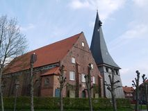 Church with sloping walls in the Alte Land Germany, nave made of brick, church tower panelled with wood royalty free stock photo