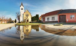 Church in Slovakia village Cifer with reflection stock photo