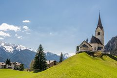 Church in small alpine village Schmitten. In canton of Graubunden Stock Photography