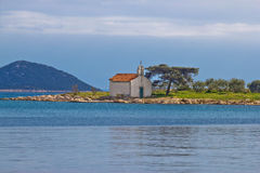 Church on small island coast Royalty Free Stock Image