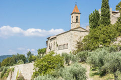 Church and small village in Tuscany Royalty Free Stock Photo