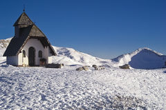 Church on snow. Church in a mountain landscape with show - Dolomites - Italy 2007 Stock Image