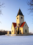 Church on snowy hill Stock Image