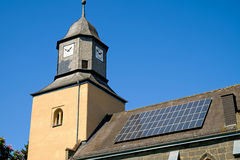 Church with solar panels royalty free stock photography
