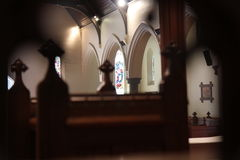 At church. Somber light in the church during prayer Royalty Free Stock Photo