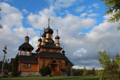 Church somewhere in Belarussian village. Hided somewhere in the Belaurssian forest national church with beautiful cloudy skies Stock Image