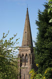 Church Spire. A church spire during summer framed by trees Stock Photos