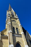 Church spire against a blue sky. Cream city brick church tower Royalty Free Stock Photography